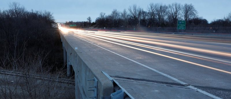 Traffic passes over a bridge for Interstate 270 that crosses Fee Fee Creek in Maryland Heights, Missouri, U.S., January 28, 2018. REUTERS/Whitney Curtis