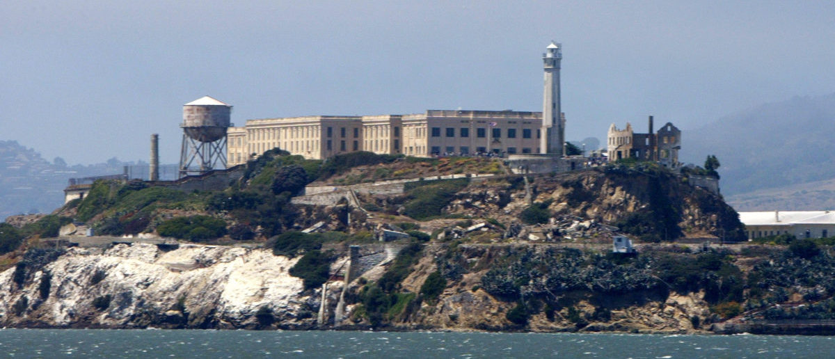 SAN FRANCISCO - JULY 2: A seagull flies over Alcatraz Federal Penitentiary on Alcatraz Island July 2, 2003 in the San Francisco Bay, California. The park service, which manages Alcatraz as one of San Francisco's most popular tourist attractions, has started selling boxed chunks of concrete rubble for $4.95 which were left over from a 7.7 million dollar retrofit of a decaying cell block and guards quarters. Park staff came up with the idea as a cost-effective alternative to ferrying tons of rubble off Alcatraz and to bring in an extra $20,000 to $40,000 a year. (Photo by Justin Sullivan/Getty Images)