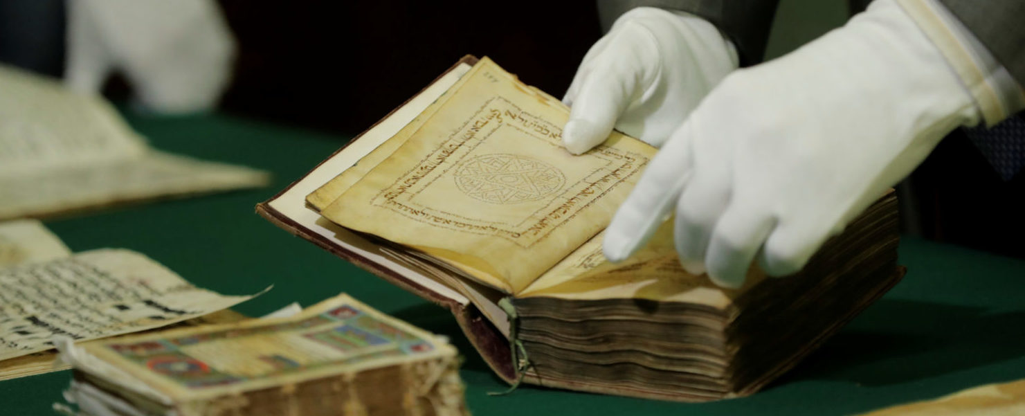 Viktor Molchanov, head of manuscript department of the Russian State Library, shows the Torah from the Guenzburg collection of ancient Hebrew manuscripts and books at the library in Moscow, Russia November 7, 2017. REUTERS/Tatyana Makeyeva