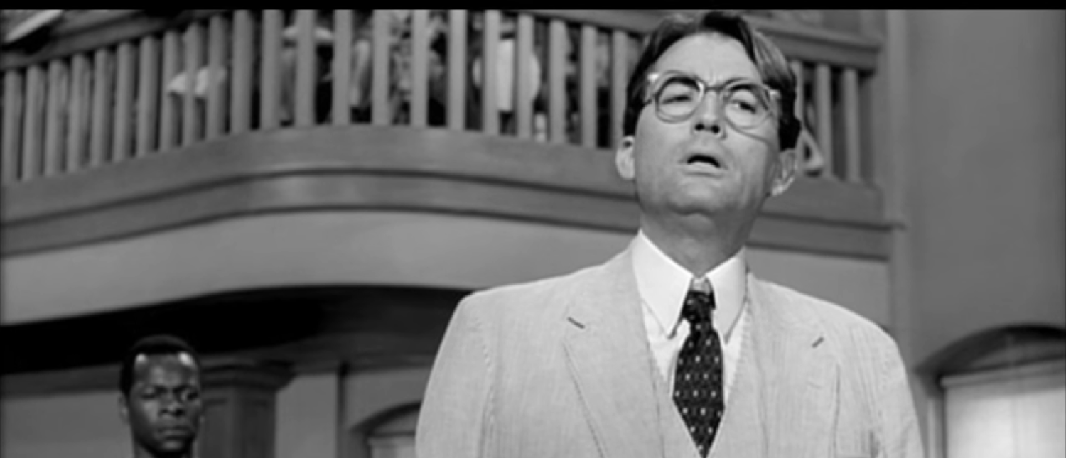 "Atticus Finch cross-examines Mayella Ewell in the 1962 rendition of ""To Kill A Mockingbird."" (Photo Credit: YouTube/Movieclips)"