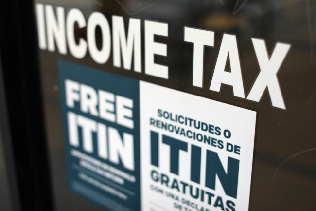 A tax sign is pictured on an H&R Block tax office in Los Angeles, April 26, 2017. REUTERS/Mike Blake