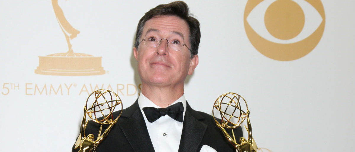 Colbert Holding Emmys (ShutterStock/Kathy Hutchins)