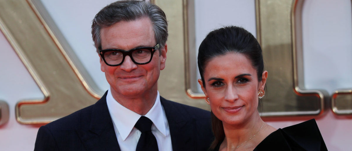 """Cast member Colin Firth arrives with his wife Livia Giuggioli for the world premiere of """"Kingsman: The Golden Circle"""" in London, Britain September 18, 2017. REUTERS/Eddie Keogh"""
