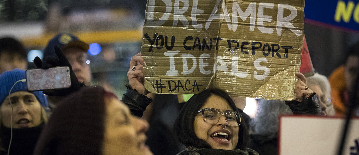 "Activists rally for the passage of a ""clean"" Dream Act, one without additional security or enforcement measures, outside the New York office of Sen. Chuck Schumer (D-NY), January 10, 2018 in New York City. The Dream Act, first introduced in 2001, is a proposed bill that would allow undocumented immigrants who came to the country as children to stay in the country legally. (Photo by Drew Angerer/Getty Images)"