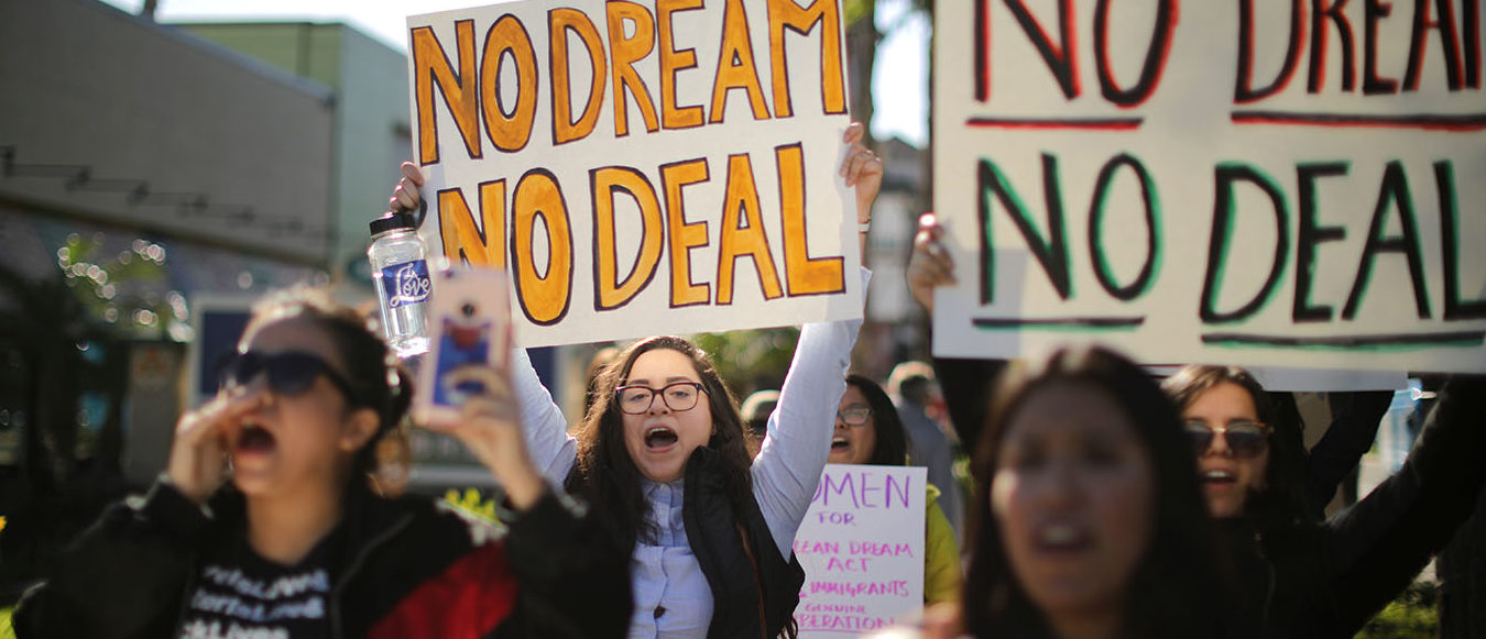 DACA recipients and supporters protest for a clean Dream Act outside Disneyland in Anaheim, California U.S. January 22, 2018. REUTERS/Lucy Nicholson - RC1C1D0C1E90
