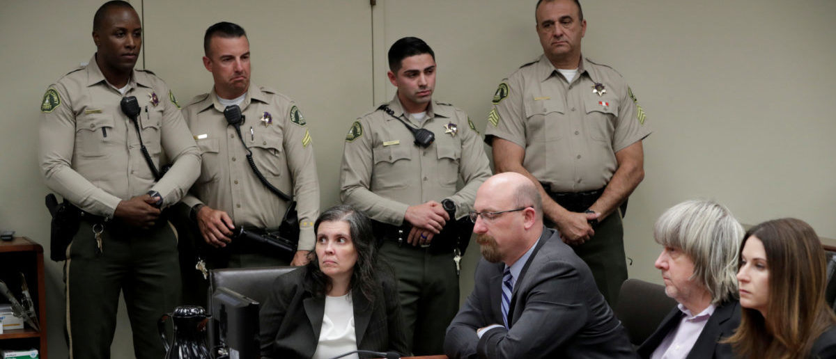 David Turpin and Louise Turpin appear in court for their arraignment in Riverside, California, U.S. January 18, 2018. REUTERS/Gina Ferazzi/Pool     TPX IMAGES OF THE DAY - RC1FD5ECAA50