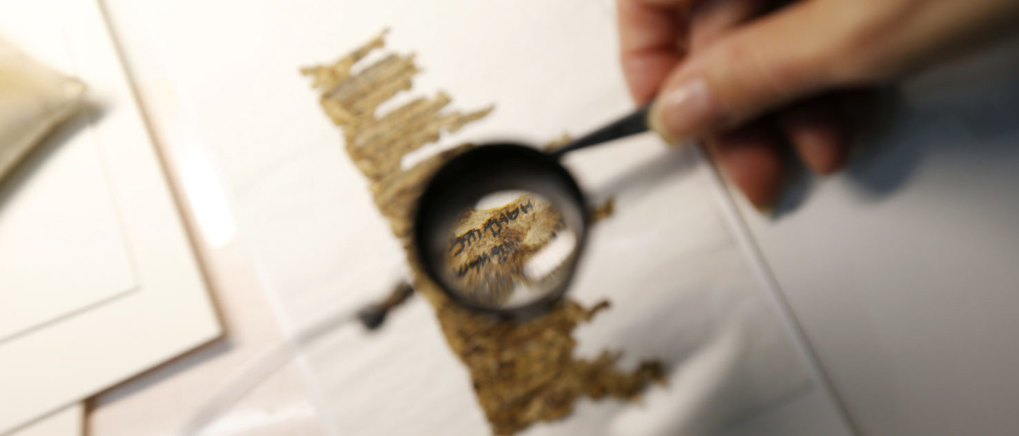 A restorer works on a fragment of the Dead Sea Scrolls in a laboratory in the Israel Museum in Jerusalem December 18, 2012. Israel Antiquities Authority, the custodian of the scrolls that shed light on the life of Jews and early Christians at the time of Jesus, and Google Israel launched on Tuesday a website featuring an online archive of high-resolution images of the 2,000-year-old scrolls. REUTERS/Ronen Zvulun