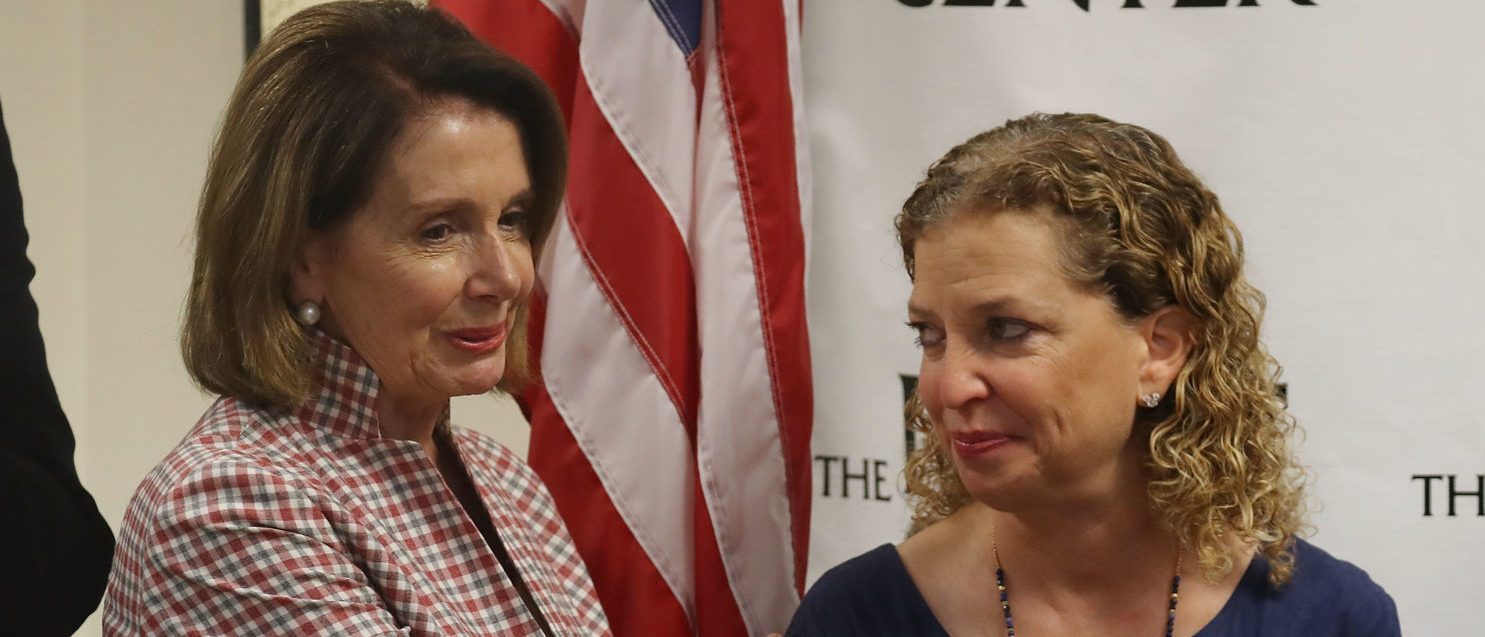 WILTON MANORS, FL - MAY 26: House Minority Leader Rep. Nancy Pelosi (D-CA) and Rep. Debbie Wasserman Schultz (D-FL) attend a discussion about LGBT rights at the Pride Center on May 26, 2017 in Wilton Manors, Florida. The discussion centered around the Equality Act, a bill that hopes to amend the Civil Rights Act of 1964 to guarantee protections to LGBT individuals. (Photo by Joe Raedle/Getty Images) | Congress, DWS Violated Cyber Protocol
