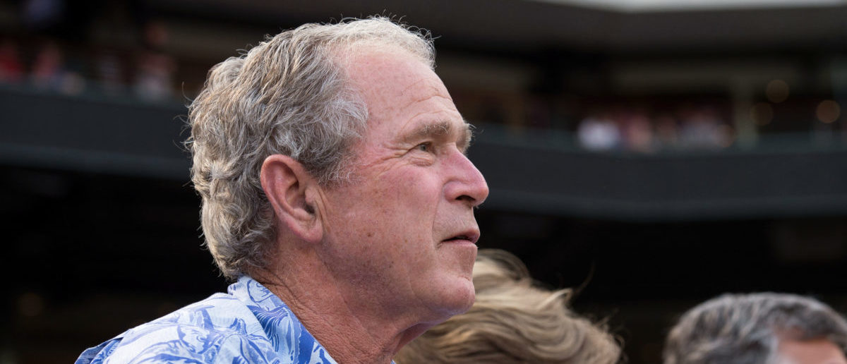 Aug 26, 2015; Arlington, TX, USA; Former president George W Bush watches the game between the Texas Rangers and the Toronto Blue Jays at Globe Life Park in Arlington. Mandatory Credit: Jerome Miron-USA TODAY Sports