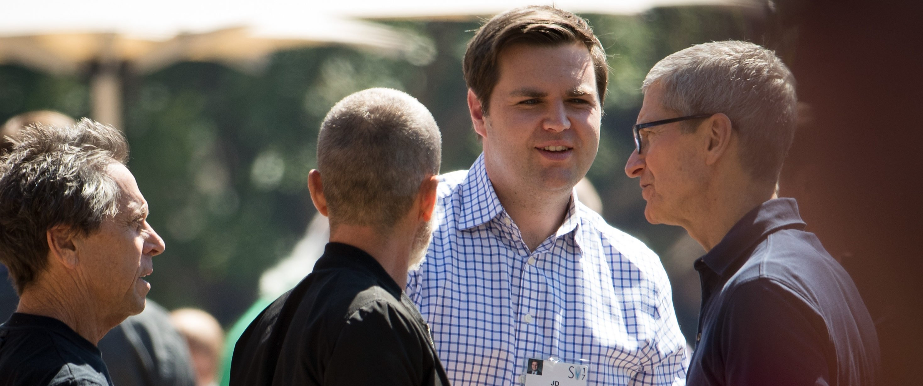 SUN VALLEY, ID - JULY 13: Venture capitalist and author JD Vance (2nd from R) shakes hands with Tim Cook (R), chief executive officer of Apple, on the third day of the annual Allen & Company Sun Valley Conference, July 13, 2017 in Sun Valley, Idaho. Every July, some of the world's most wealthy and powerful businesspeople from the media, finance, technology and political spheres converge at the Sun Valley Resort for the exclusive weeklong conference. (Photo by Drew Angerer/Getty Images)