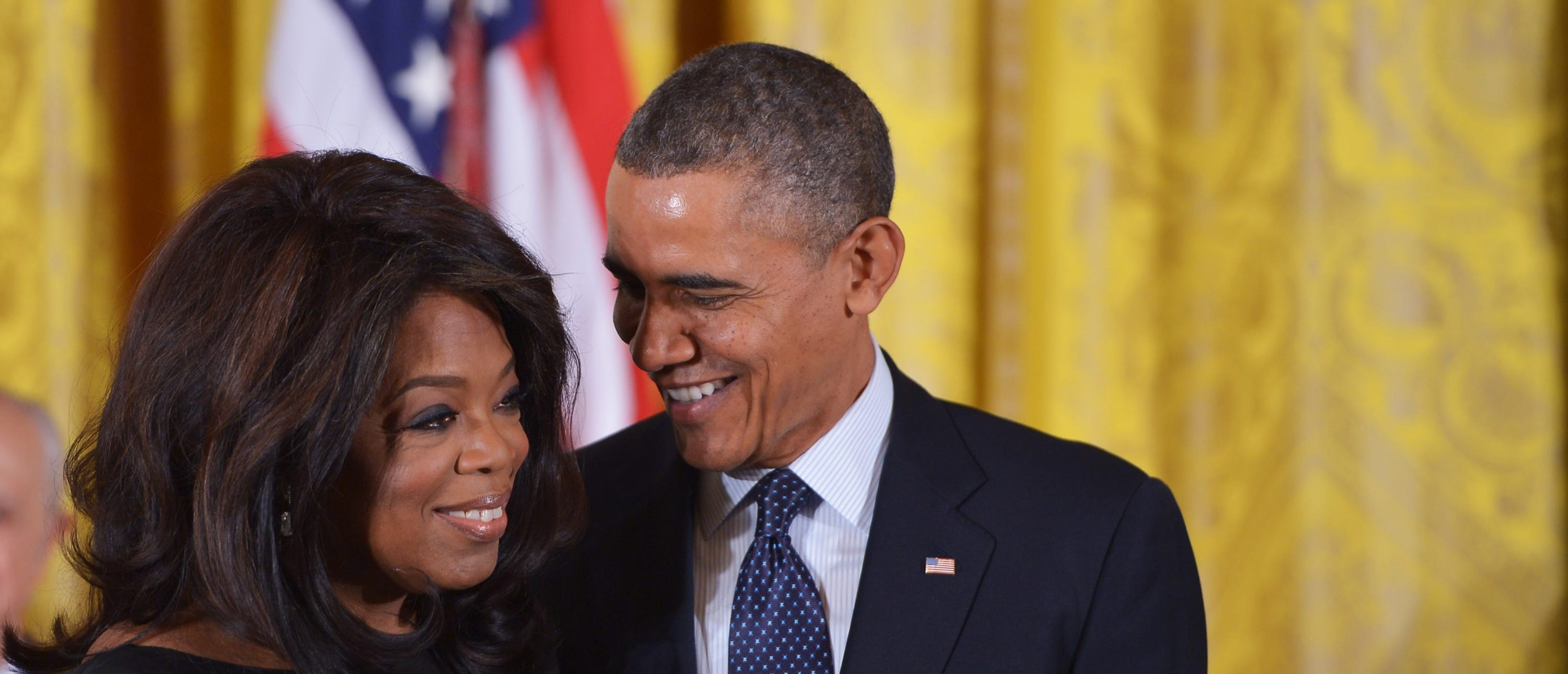 US President Barack Obama chats with broadcast journalist Oprah Winfrey after presenting the Presidential Medal of Freedom during a ceremony in the East Room of the White House on November 20, 2013 in Washington, DC. The Medal of Freedom is the country's foremost civilian honor.  AFP PHOTO/Mandel NGAN        (Photo credit should read MANDEL NGAN/AFP/Getty Images)