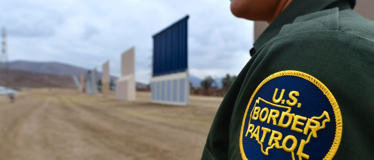 The concrete and steel structures, erected in a remote area in San Diego, will be tested for 30 to 60 days to determine which design meets the needs to secure the border, US Customs and Border Patrol Protection said in a statement. Authorities said that in considering the mockups -- built by six companies from across the United States -- they will evaluate a number of characteristics including anti-breaching, anti-climbing and anti-digging capabilities. / AFP PHOTO / FREDERIC J. BROWN (Photo credit should read FREDERIC J. BROWN/AFP/Getty Images)