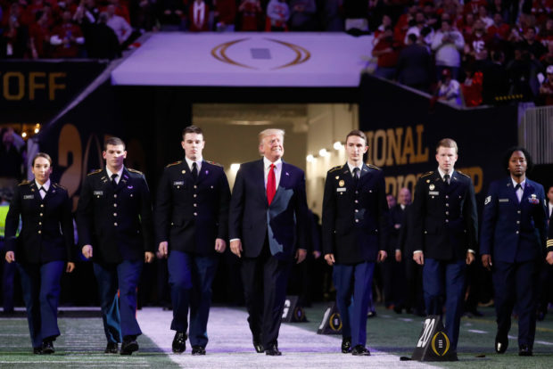 US President Donald Trump sings national anthem to mixed reception