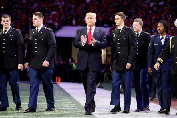 Trump Enters Stadium for College National Championship to Cheers, Sings National Anthem