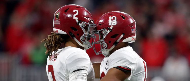 ATLANTA, GA - JANUARY 08: Tua Tagovailoa #13 celebrates a touchdown pass with Jalen Hurts #2 of the Alabama Crimson Tide during the third quarter against the Georgia Bulldogs in the CFP National Championship presented by AT&T at Mercedes-Benz Stadium on January 8, 2018 in Atlanta, Georgia.  (Photo by Streeter Lecka/Getty Images)