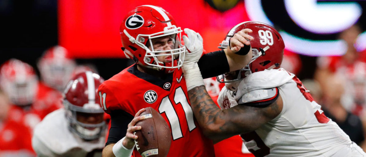 ATLANTA, GA - JANUARY 08: Jake Fromm #11 of the Georgia Bulldogs is sacked by Raekwon Davis #99 of the Alabama Crimson Tide during the second half in the CFP National Championship presented by AT&T at Mercedes-Benz Stadium on January 8, 2018 in Atlanta, Georgia. (Photo by Kevin C. Cox/Getty Images)