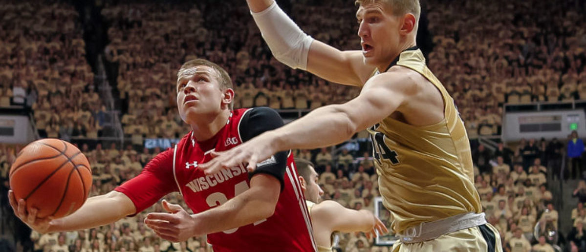 WEST LAFAYETTE, IN - JANUARY 16: Brad Davison #34 of the Wisconsin Badgers shoots the ball against Isaac Haas #44 of the Purdue Boilermakers at Mackey Arena on January 16, 2018 in West Lafayette, Indiana. (Photo by Michael Hickey/Getty Images)