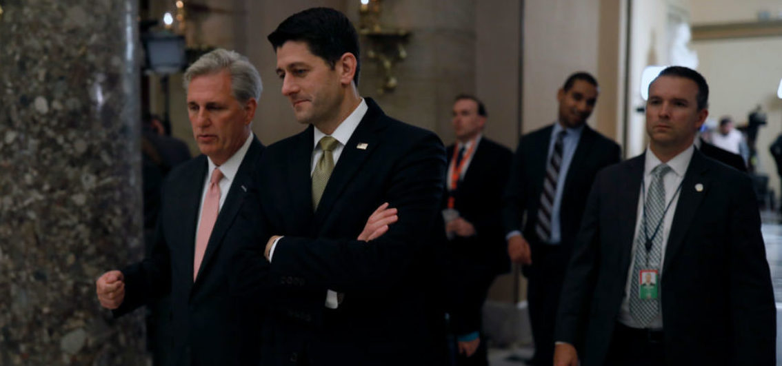 WASHINGTON, DC - JANUARY 18: Speaker of the House Paul Ryan, at right, and House Majority Leader Kevin McCarthy speak as they walk to a news conference at the U.S. Capitol January 18, 2018 in Washington, DC. A continuing resolution to fund the government has passed the House of Representatives but faces a stiff challenge in the Senate. (Photo by Aaron P. Bernstein/Getty Images)