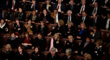 Large group of Democrats decked in black atttire sit in discontent. (Photo credit: SMIALOWSKI/AFP/Getty Images)