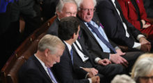 Democratic lawmakers keep themselves occupied while Trump speaks.(Photo by Chip Somodevilla/Getty Images)