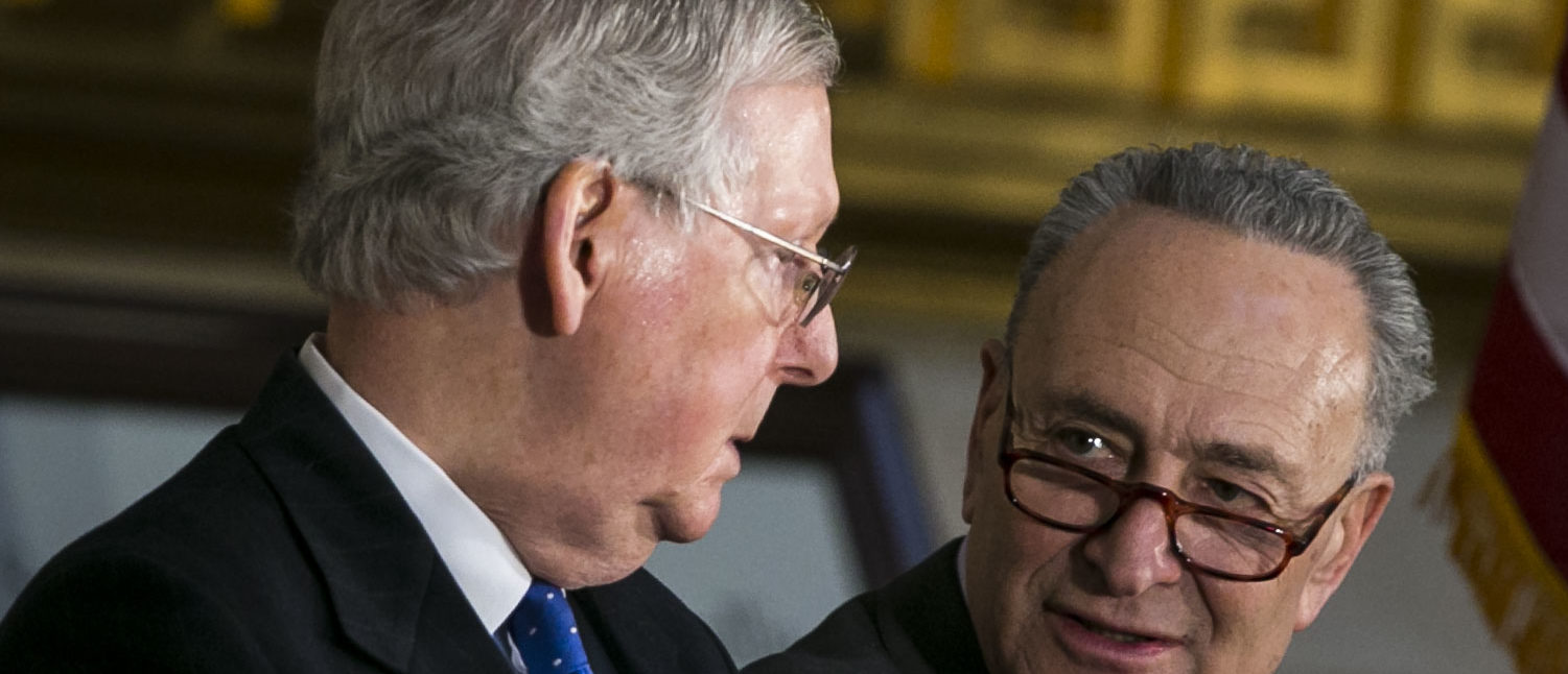 Senate Majority Leader Mitch McConnell and Senate Minority Leader Chuck Schumer talk during the congressional Gold Medal ceremony for former Senate Majority Leader Bob Dole at the U.S. Capitol January 17, 2018 in Washington D.C. (Photo by Al Drago-Pool/Getty Images)