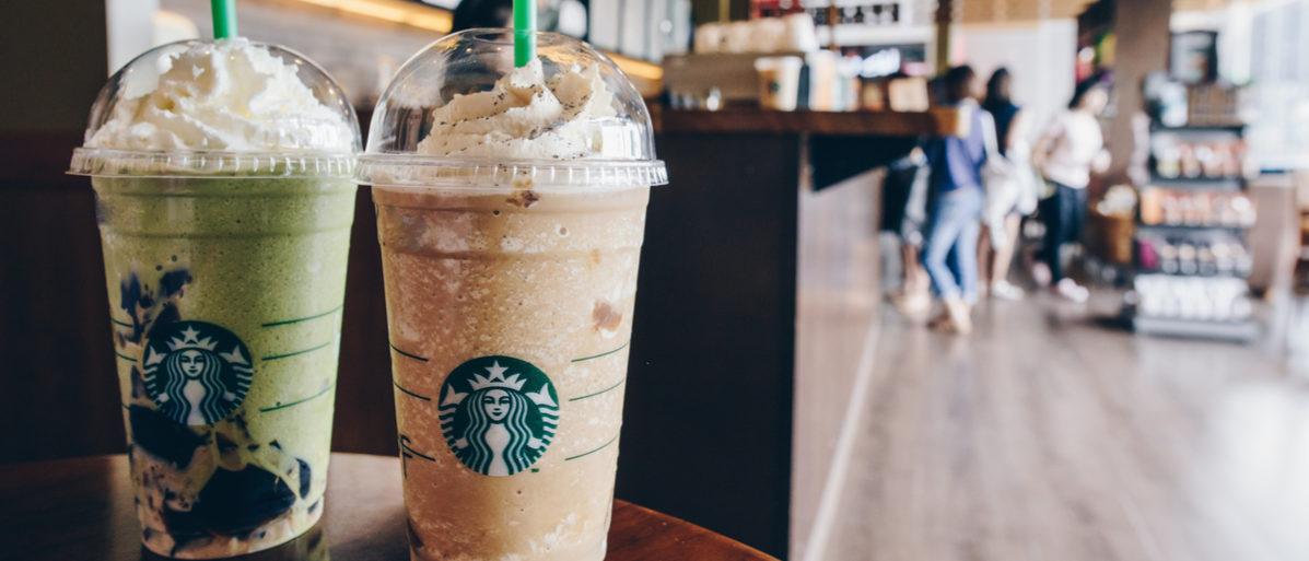 CHIANG RAI, THAILAND- July-02-2017 : A Venti Starbucks frappuccino Irish coffee and Green tea latte frappuccino in Starbucks coffee shop. Shutterstock/ Boyloso