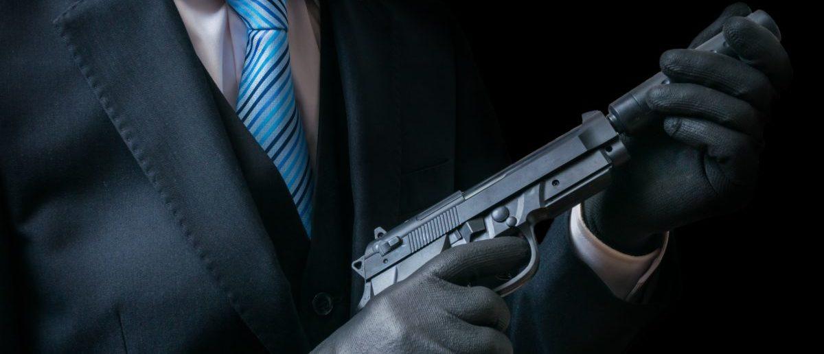Hitman With Silenced Pistol (ShutterStock/Vchal)