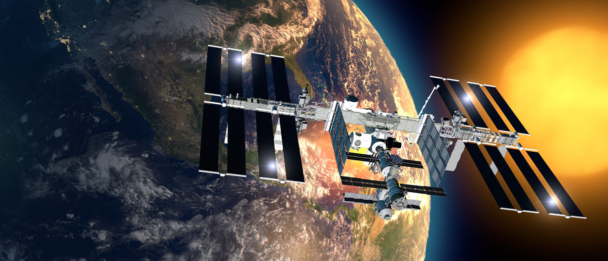 International Space Station in orbit around the earth. Element of this image are furnished by NASA. (Shutterstock/Naeblys)