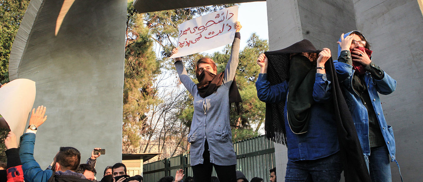 Iranian students protest at the University of Tehran during a demonstration driven by anger over economic problems, in the capital Tehran on December 30, 2017. Students protested in a third day of demonstrations sparked by anger over Iran's economic problems, videos on social media showed, but were outnumbered by counter-demonstrators. STR/AFP/Getty Images
