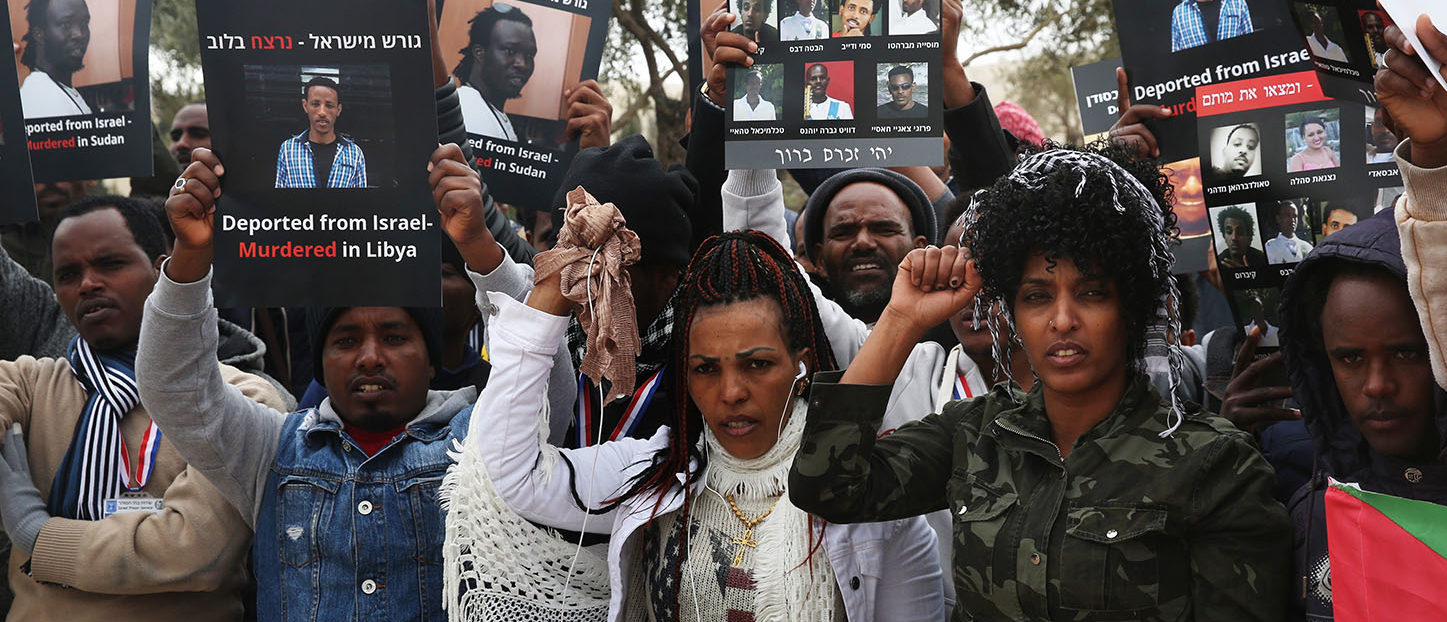 African asylum seekers, mostly from Eritrea, who entered Israel illegally during the past years, hold placards showing migrants who they say were killed after being deported to their country, during a protest against Israel's deportation policy in front of the Supreme Court in Jerusalem on January 26, 2017. MENAHEM KAHANA/AFP/Getty Images