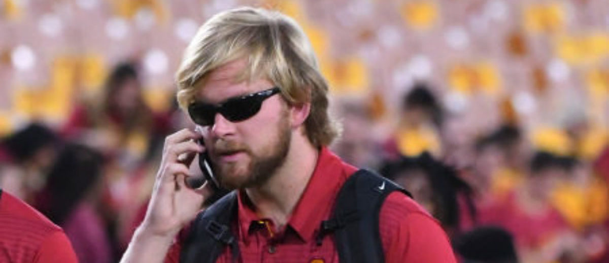 LOS ANGELES, CA - NOVEMBER 04: Long snapper Jake Olson (61) of the USC Trojans arrives for the game against the Arizona Wildcats with his guide dog Quebec at the Los Angeles Memorial Coliseum on November 4, 2017 in Los Angeles, California. (Photo by Jayne Kamin-Oncea/Getty Images)