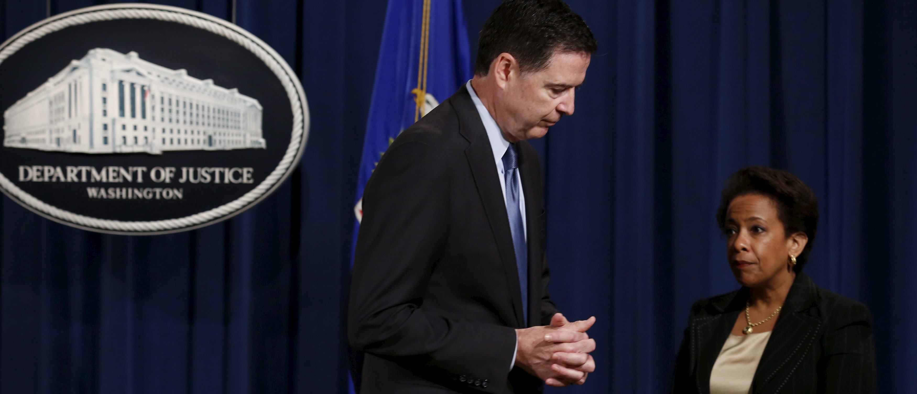 FBI Director James Comey and U.S. Attorney General Loretta Lynch attend a news conference at the Justice Department in Washington June 18, 2015. REUTERS/Yuri Gripas