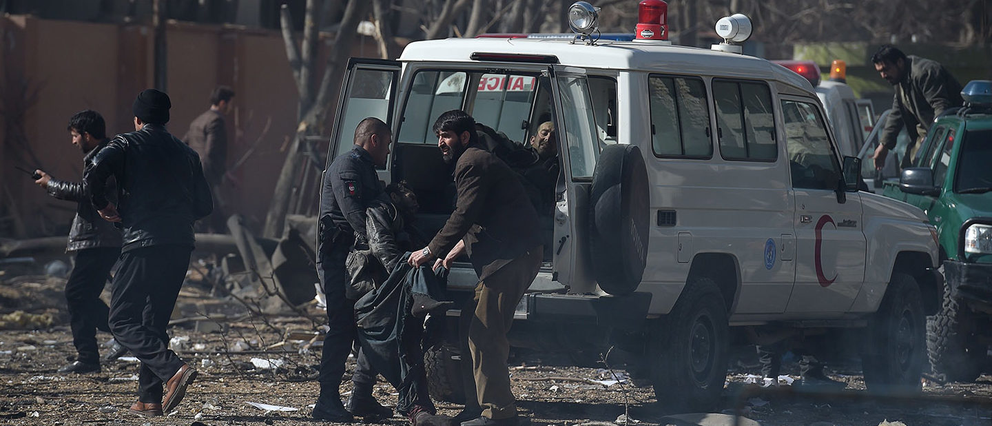 Afghan volunteers and policemen carry injured men on an ambulance at the scene of a car bomb exploded in front of the old Ministry of Interior building in Kabul on January 27, 2018. An ambulance packed with explosives blew up in a crowded area of Kabul on January 27, killing at least 17 people and wounding 110 others, officials said, in an attack claimed by the Taliban. WAKIL KOHSAR/AFP/Getty Images