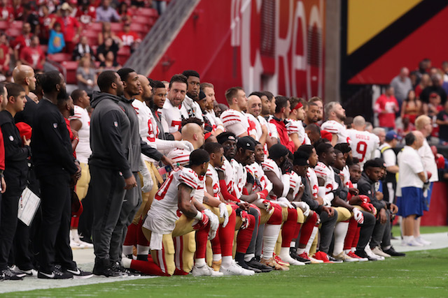 GLENDALE, AZ - OCTOBER 01: Members of the San Francisco 49ers kneel for the National Anthem before the start of the NFL game against the Arizona Cardinals at the University of Phoenix Stadium on October 1, 2017 in Glendale, Arizona. (Photo by Christian Petersen/Getty Images)