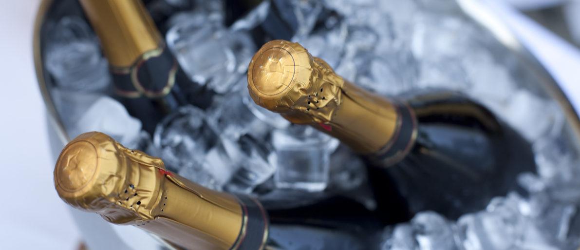 Bottles of Champagne in cooler. Shutterstock/ Andreas Prott