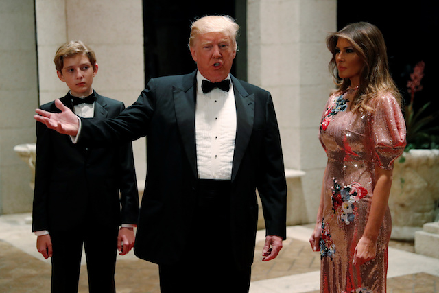 U.S. President Donald Trump and first lady Melania Trump, with their son Barron, arrive for a New Year's Eve party at his Mar-a-Lago club in Palm Beach, Florida, U.S. December 31, 2017. REUTERS/Jonathan Ernst - RC1699A89940