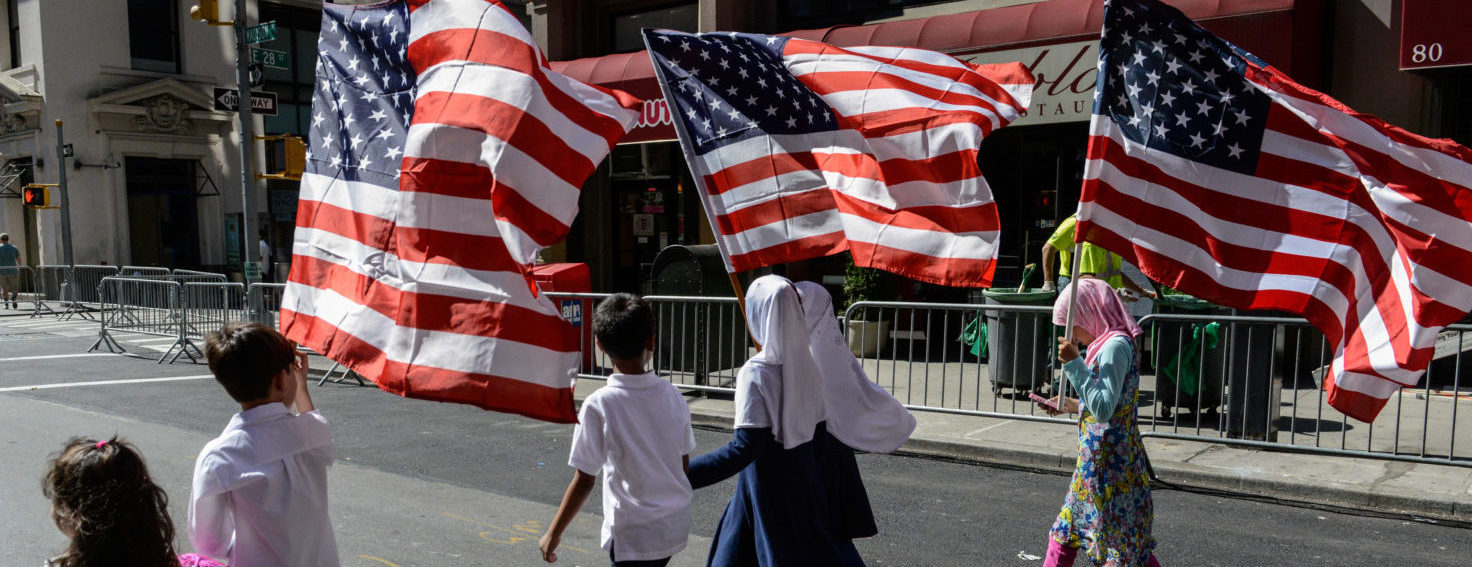 Children carry American flags during in the annual Muslim Day Parade in New York City, U.S. September 24, 2017. REUTERS/Stephanie Keith