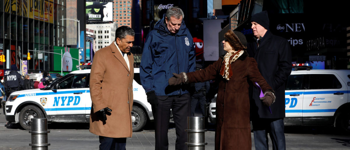 New York City Mayor Bill de Blasio, New York City Department of Transportation Commissioner Polly Trottenberg, NYPD Commissioner James O'Neill (R) and U.S. Congressman Adriano Espaillat (D-NY) stand near additional bollards on sidewalks and plazas to protect pedestrians in Times Square, New York City, New York, U.S., January 2, 2018. REUTERS/Mike Segar