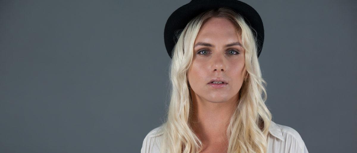 Here is a portrait of a transgender woman wearing a hat. (Shutterstock/wavebreakmedia)