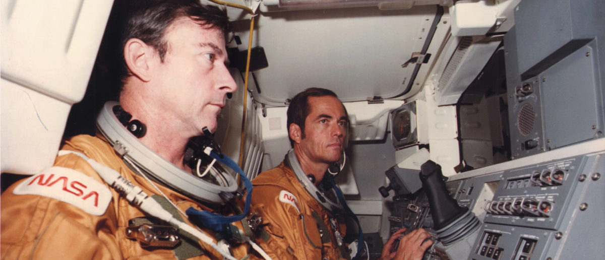 Looking aft toward the cargo bay of NASA's Space Shuttle Orbiter 102 vehicle, Columbia, Astronauts John Young (L) and Robert Crippen preview some of the intravehicular activity expected to take place during the orbiter's flight test, at Kennedy Space Center October 10, 1980. REUTERS/NASA/Kennedy Space Center/Handout