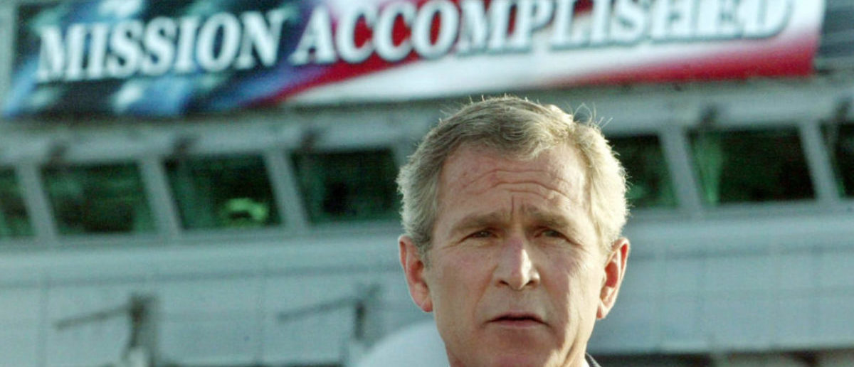 "The White House said on October 29, 2003 that it had helped with the production of a ""Mission Accomplished"" banner as a backdrop for President George W. Bush's speech onboard the USS Abraham Lincoln to declare combat operations over in Iraq. This file photo shows Bush delivering a speech to crew aboard the aircraft carrier USS Abraham Lincoln, as the carrier steamed toward San Diego, California on May 1, 2003. REUTERS/Larry Downing/FILE KL/GN/GAC - RP4DRHZUMBAA"