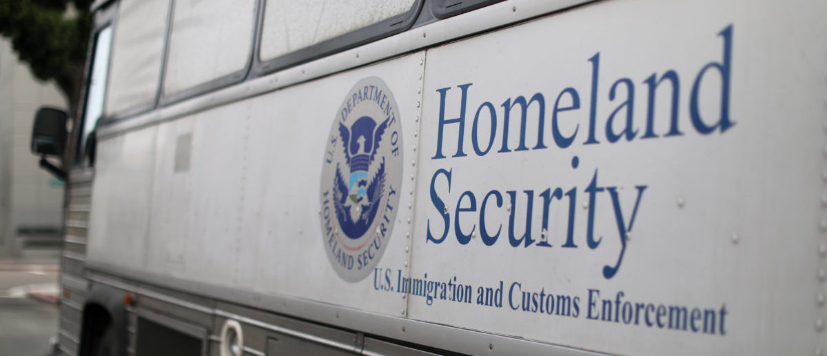 A Homeland Security Immigration and Customs Enforcement (ICE) bus is seen parked outside a federal jail in San Diego, California, U.S. October 19, 2017. REUTERS/Mike Blake - RC16127D02A0