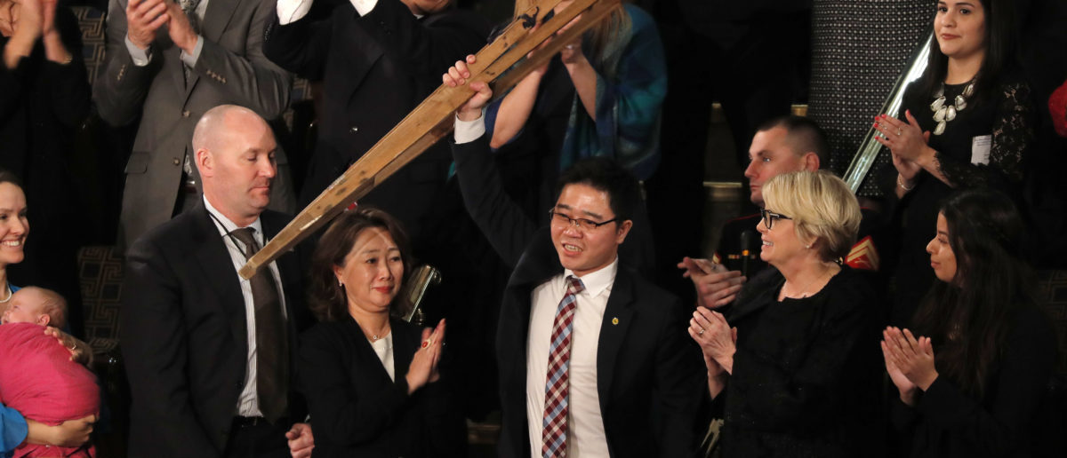 North Korean defector Ji Seong-ho, currently a law student at Dongguk University, holds up his crutches as he is ackowledged by U.S. President Donald Trump during his State of the Union address to a joint session of the U.S. Congress on Capitol Hill in Washington, U.S. January 30, 2018. REUTERS/Carlos Barria
