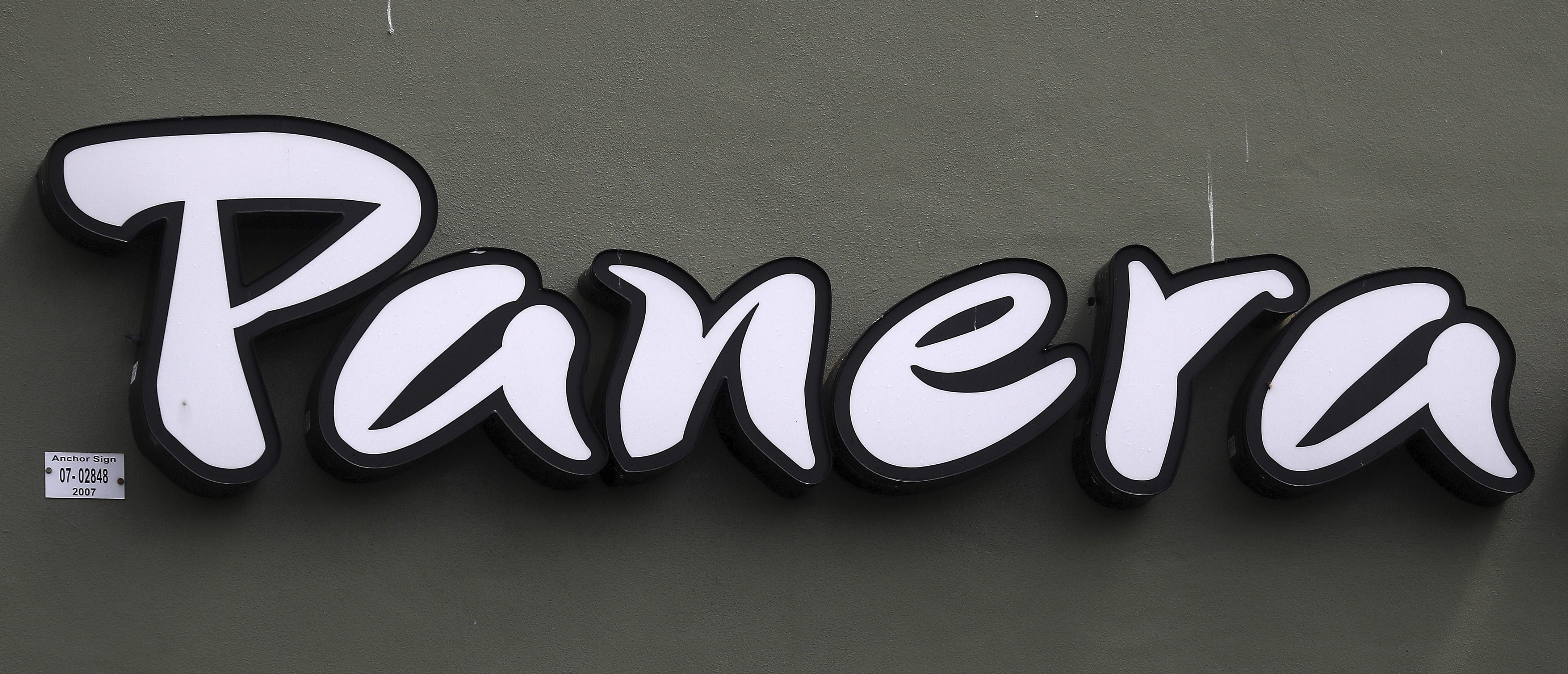 A Panera restaurant logo is pictured on a building in North Miami, Florida March 19, 2016. REUTERS/Carlo Allegri - GF10000352444