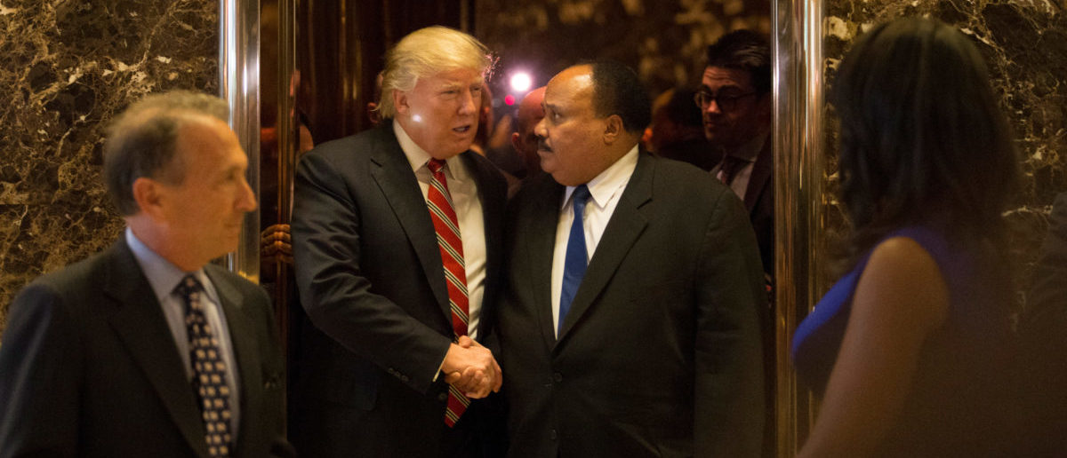 U.S. President-elect Donald Trump shakes hands with Martin Luther King III, an American human rights advocate, at Trump Tower in Manhattan, New York City, U.S., January 16, 2017. REUTERS/Alex Wroblewski - RC12B59089A0