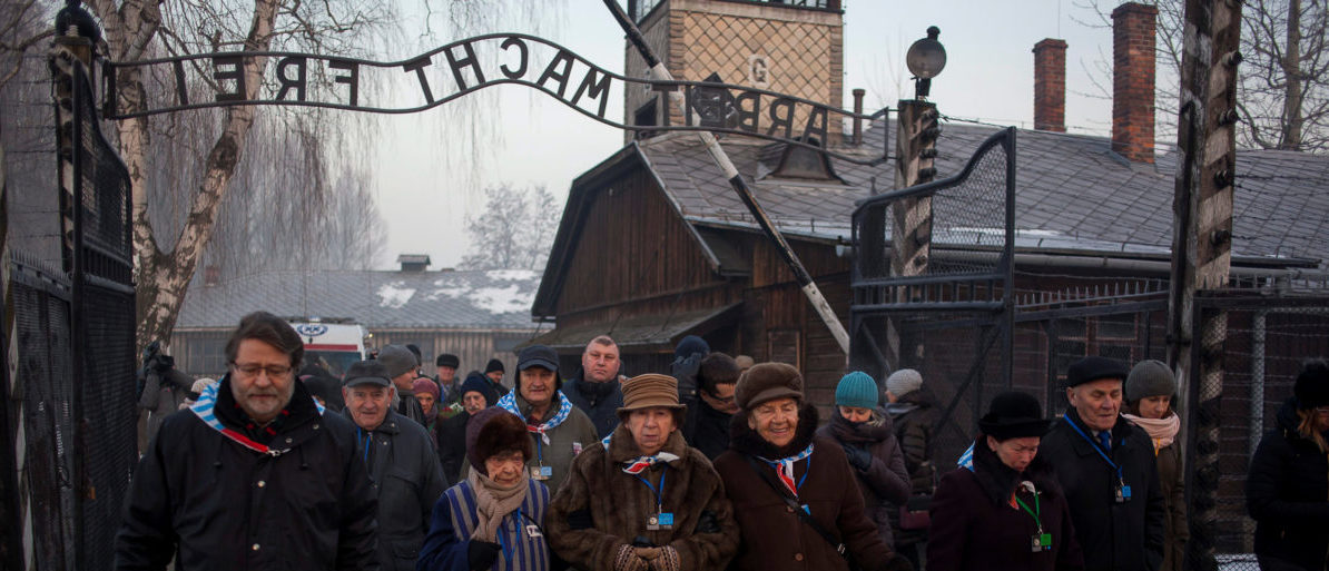 Survivors walk in the former Nazi German concentration and extermination camp Auschwitz-Birkenau in Oswiecim, Poland January 27, 2017, to mark the 72nd anniversary of the liberation of the camp by Soviet troops and to remember the victims of the Holocaust. (Photo: Agency Gazeta/Kuba Ociepa/via REUTERS)