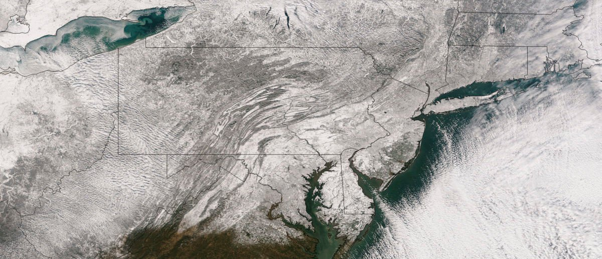 A NOAA handout image taken from space on January 3, 2014 by the Suomi NPP satellite shows a blanket of snow that stretches from the midwestern region of the United States across to New England after a massive winter storm moved over the region. The Great Lakes region is shown in upper left and states of Delaware, New Jersey and New York are included in lower right.  REUTERS/NASA/NOAA/Handout via Reuters