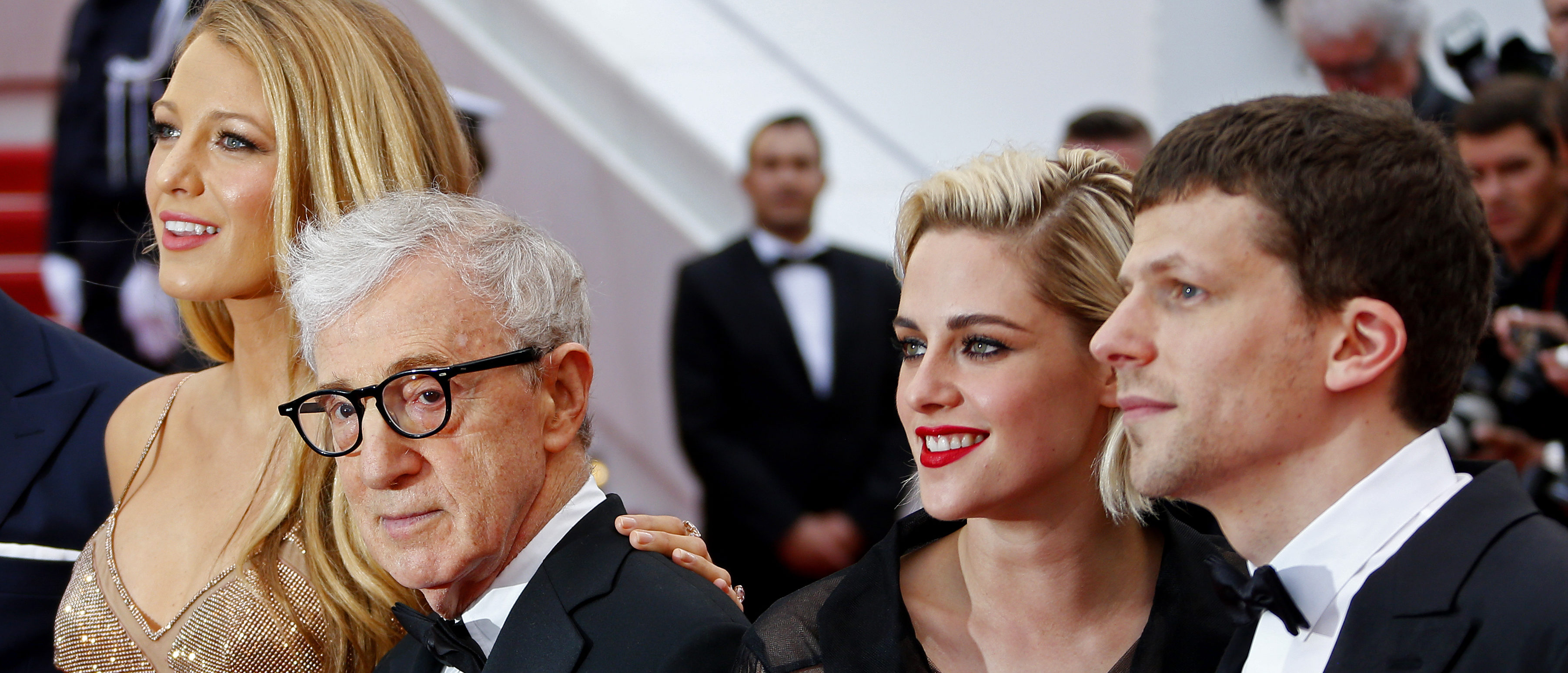 """Director Woody Allen (2ndL) and cast members (L-R) Blake Lively, Kristen Stewart and Jesse Eisenberg pose on the red carpet as they arrive for the opening ceremony and the screening of the film """"Cafe Society"""" out of competition during the 69th Cannes Film Festival in Cannes, France, May 11, 2016. REUTERS/Yves Herman - LR1EC5B1E4FPT"""