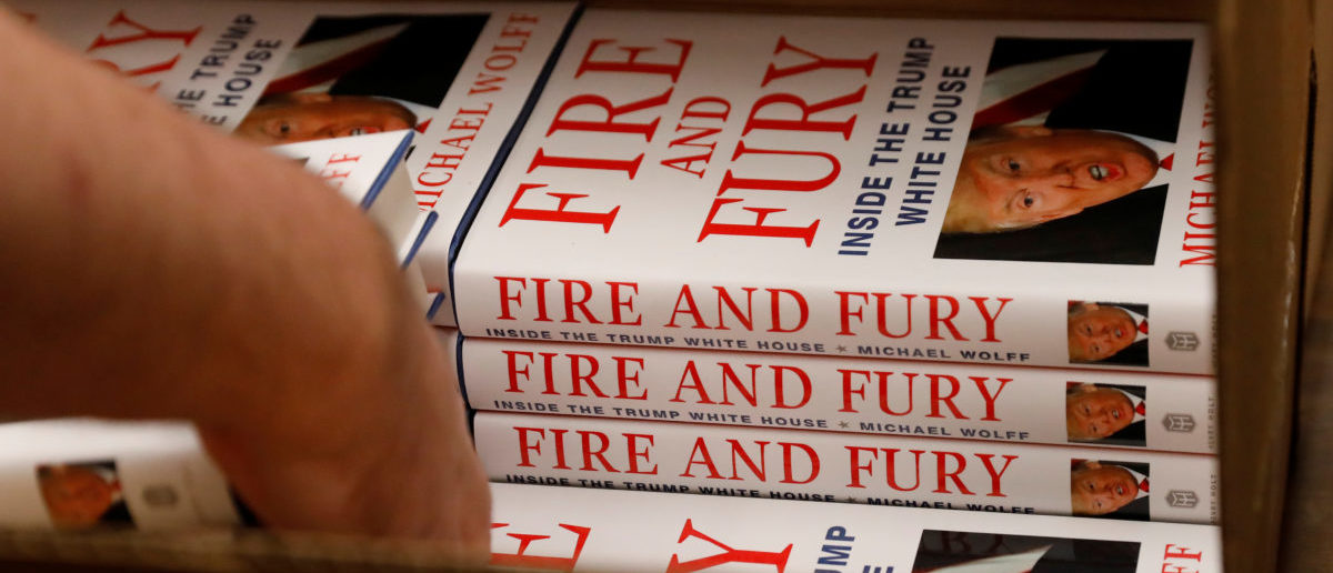 "An employee of Book Culture book store unloads copies of ""Fire and Fury: Inside the Trump White House"" by author Michael Wolff inside the store in New York, U.S. January 5, 2018. REUTERS/Shannon Stapleton"