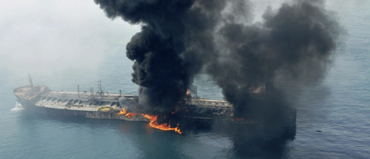 Smoke billows into the sky off the coast of Dubai after two ships collided causing a fire
